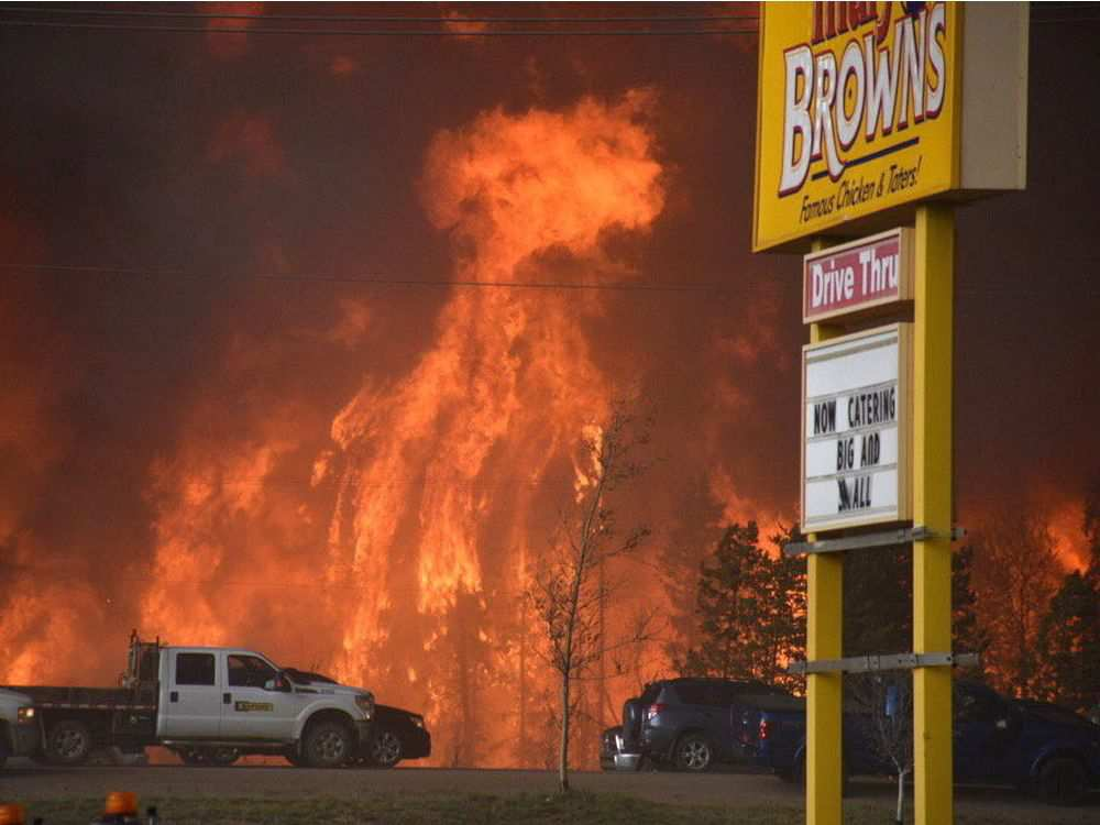 A wall of fire rages outside of Fort McMurray on Tuesday May 3, 2016. TERRY REITH / THE CANADIAN PRESS